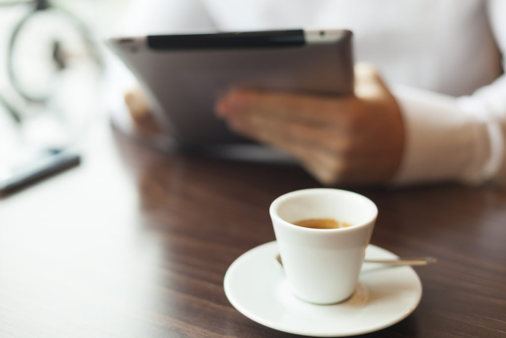 Man Reading News At Motning On Tablet Computer
